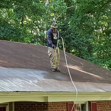 Getting the grime off a roof.